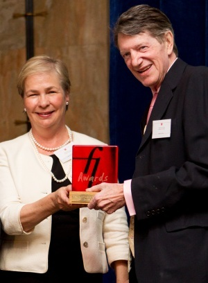 John Cornwell accepting his Family Law Award from Martha Cover from Coram Chambers